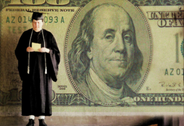 graduate student holding money