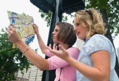 2 students with a map
