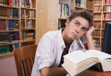high school junior studying in library