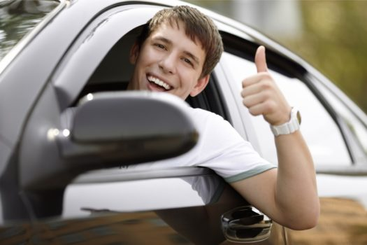 student driving a car