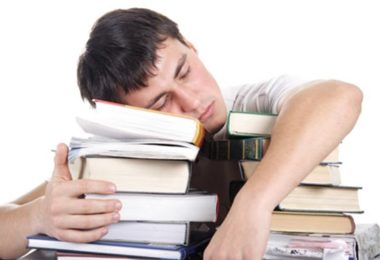 student sleep with books