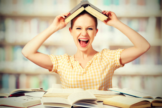 funny student shouts with books