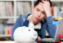 young man worried about paying for college